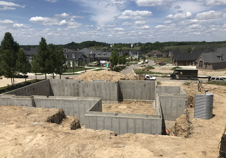 photo of a home foundation being built in a housing development.