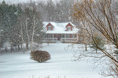 house in winter covered in snow